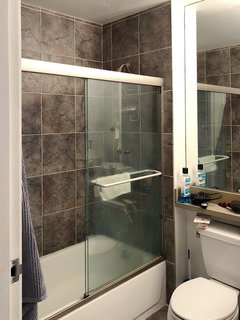 Before: The original, builder-grade materials made the 40-square-foot bathroom feel dark and small.