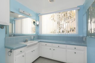 The home features one full bath and three partial baths.