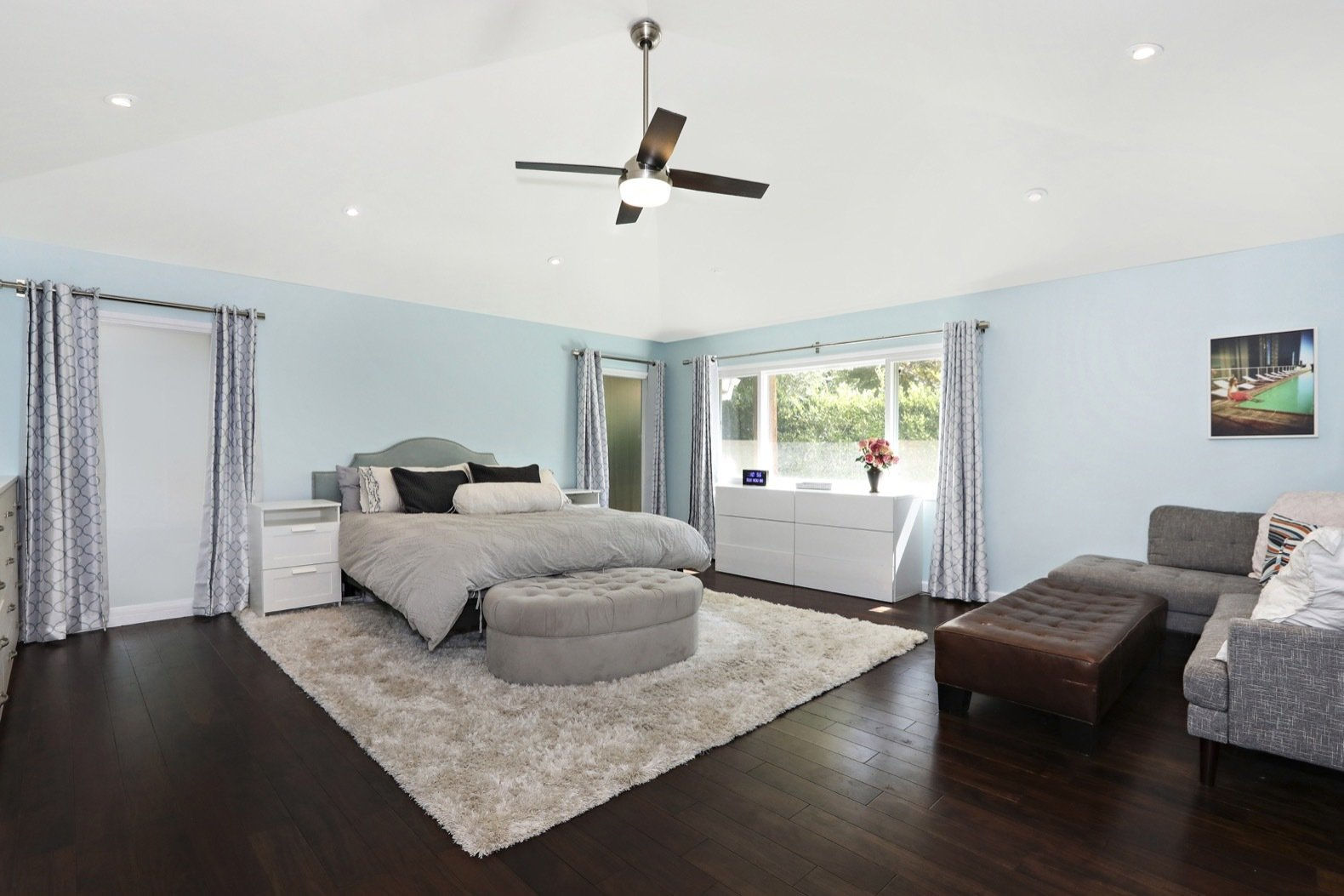 Bedroom, Night Stands, Dark Hardwood, Storage, Ceiling, Bed, and Recessed An addition built by the former owners was gut renovated and transformed into a new master suite with hardwood floors.   Best Bedroom Dark Hardwood Night Stands Storage Photos from Own Comedian Adam Carolla's Renovated L.A. Midcentury For $3.4M
