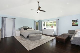 An addition built by the former owners was gut renovated and transformed into a new master suite with hardwood floors.