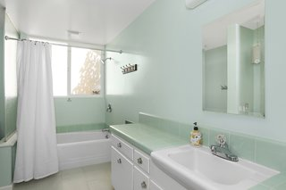 The kids' bathrooms include original fixtures and tiles along with new flooring.