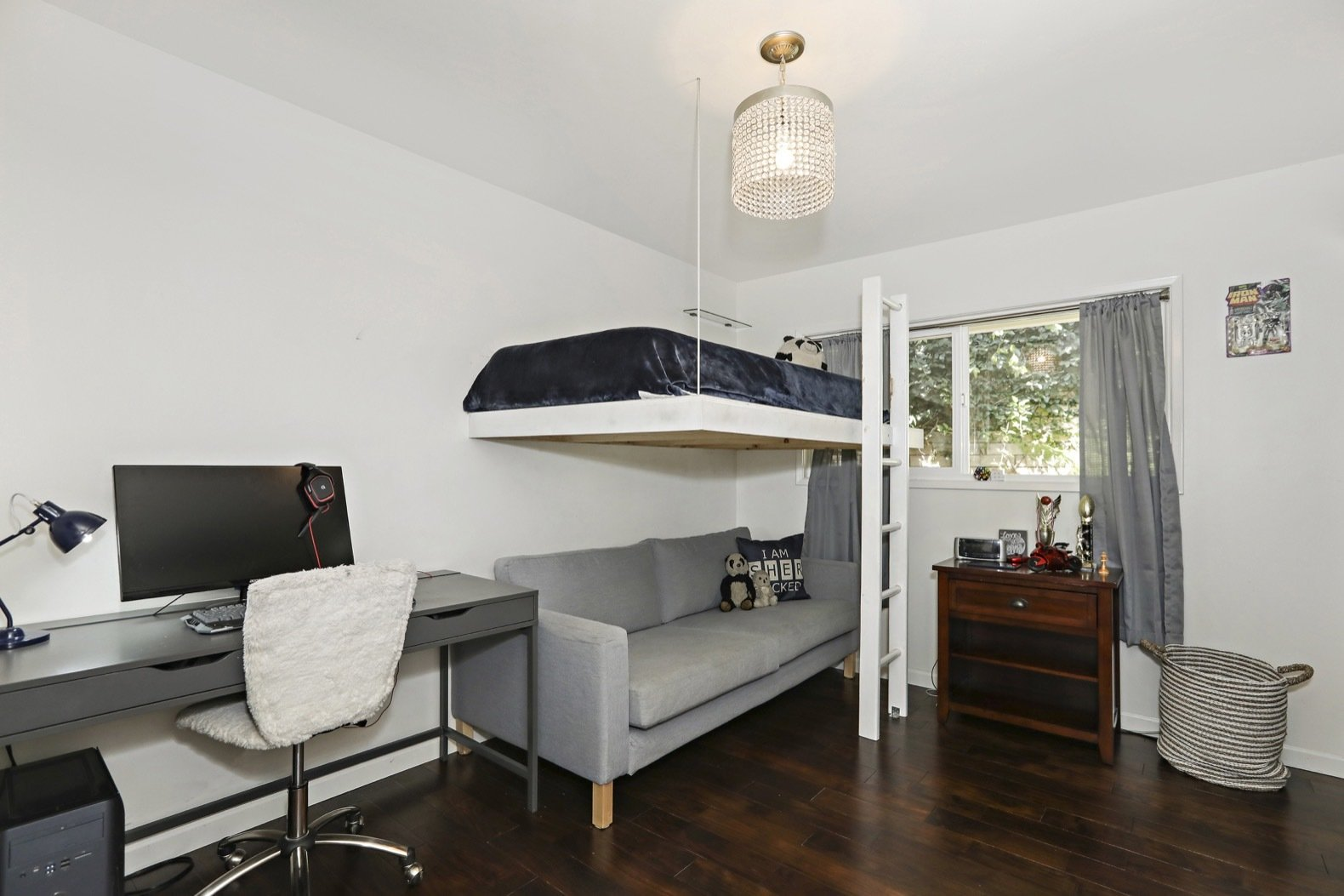 Adam Carolla designed and custom-built a loft bed for his son's bedroom.   Bedroom Pendant Chair Dark Hardwood Photos from Own Comedian Adam Carolla's Renovated L.A. Midcentury For $3.4M