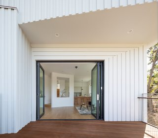 Folding aluminum-framed glass doors facilitate a seamless transition between indoors and out.