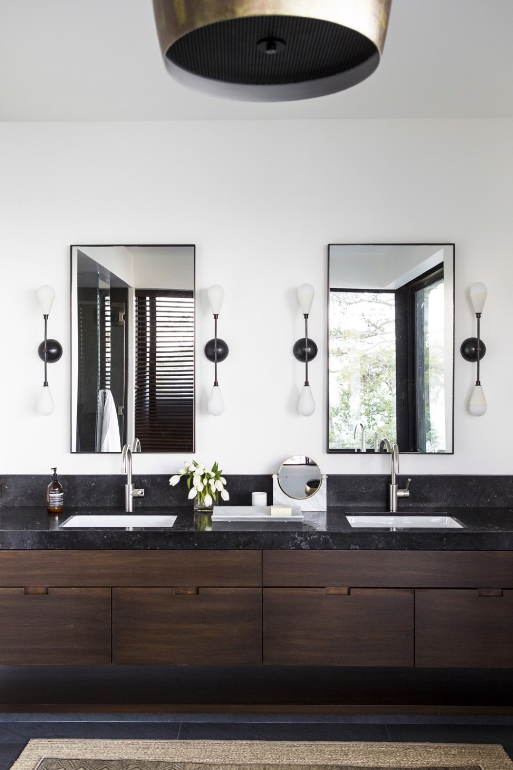 Bath Room, Pendant Lighting, Undermount Sink, Wall Lighting, and Granite Counter The master bath is fitted out with custom teak cabinetry topped with Aged Petit Granit counters.  Photo 10 of 14 in An Energy-Conscious Home Gets Woven Into a Waterfront Landscape