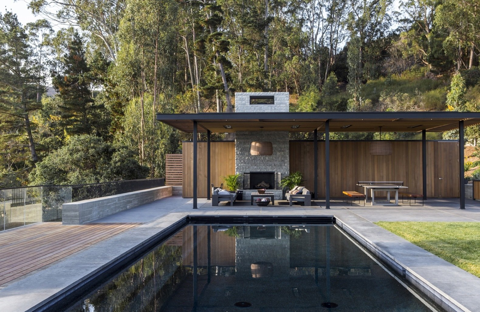 Outdoor, Large Patio, Porch, Deck, Trees, Back Yard, Shrubs, Grass, and Large Pools, Tubs, Shower Photovoltaics panels were installed at the pool house.   Photo 13 of 14 in An Energy-Conscious Home Gets Woven Into a Waterfront Landscape