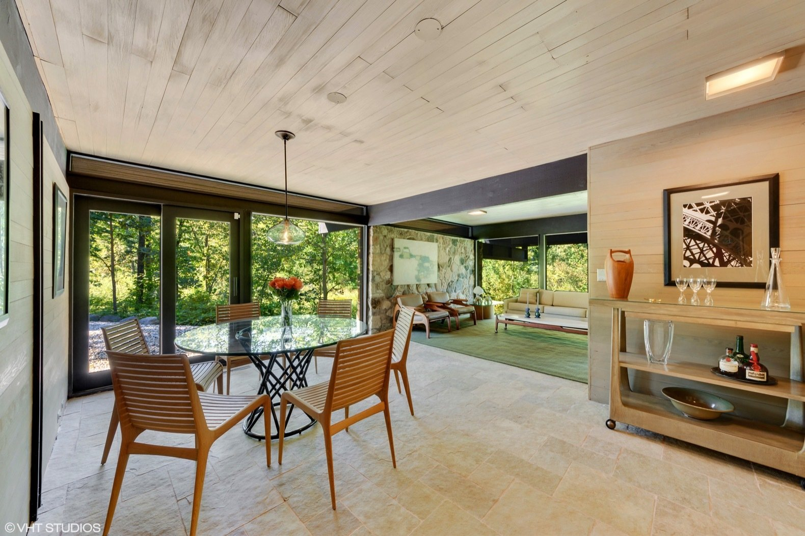 Living Room, Sofa, Ceiling Lighting, Pendant Lighting, Chair, Table, and Console Tables A look at the living and dining spaces housed in the guest wing.  Best Photos from Own a Midcentury Gem by a Frank Lloyd Wright Disciple For $1.2M