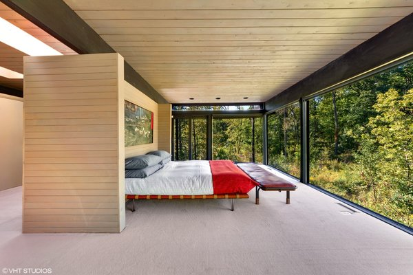 The cantilevered master suite boasts 270-degree views of the tree canopy.