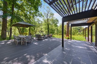 The slate floors continue seamlessly to an outdoor dining and living area outside of the kitchen.