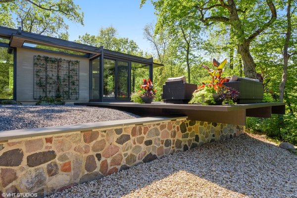 Branching off from the media room is the outdoor lounge, cantilevered over a split-face granite retaining wall.
