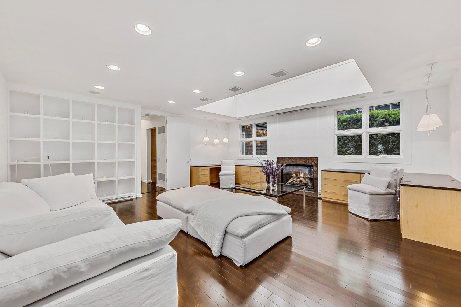 Bedroom, Recessed, Dark Hardwood, Storage, Pendant, Shelves, Bed, and Chair The current owner added hardwood floors and repainted the walls a luminous white. Pictured is a secondary bedroom with a cupola and gas fireplace.  Bedroom Pendant Chair Dark Hardwood Recessed Photos