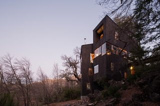 The timber-clad cabin is in the shape of a 'V' to optimize views of the Valle Las Trancas below.