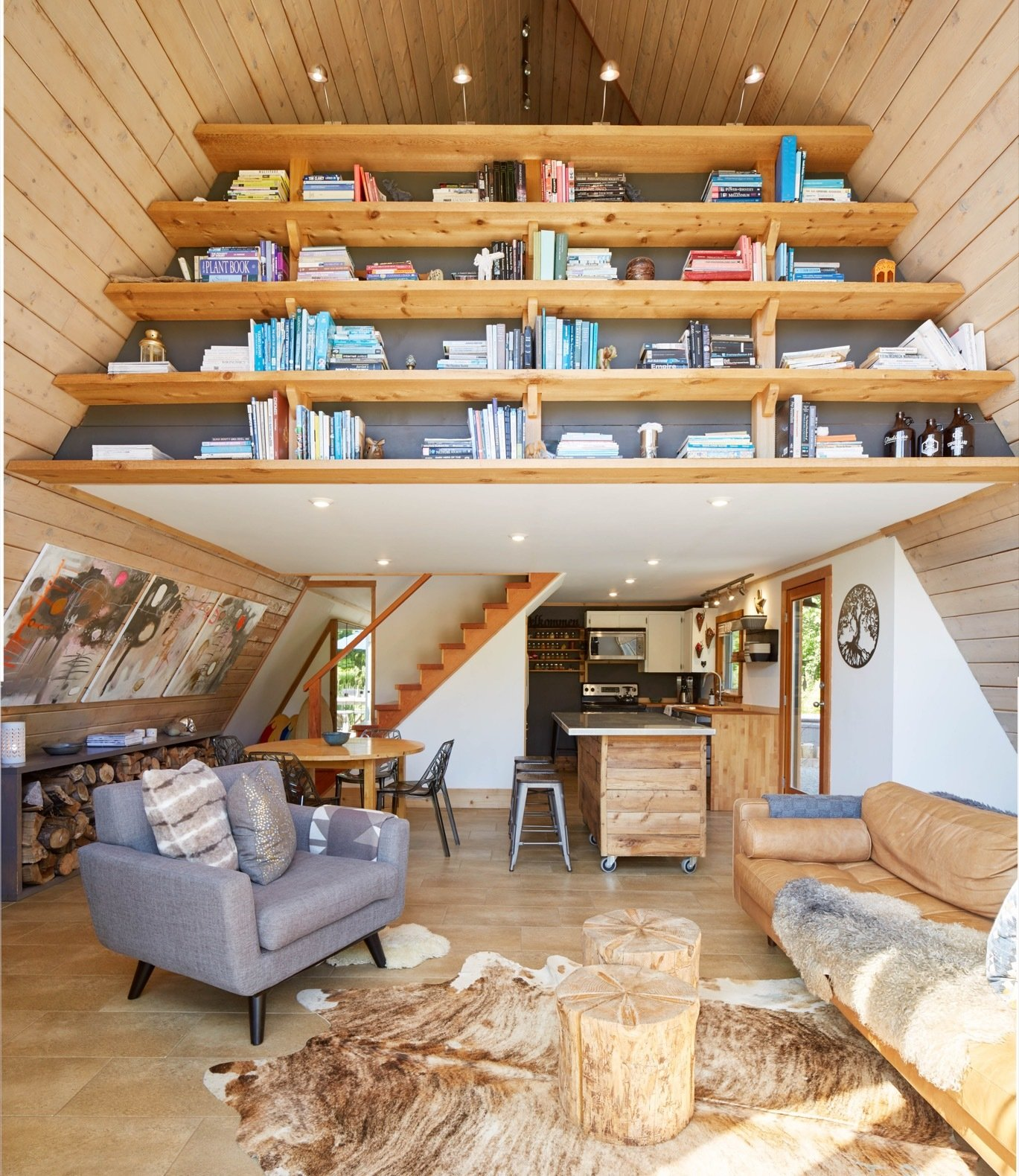 Storage Room and Shelves Storage Type Completed between the birth of their third child and Anthonie's doctoral defense, the built-in library is one of the couple's favorite features in the cabin.  Photo 1 of 13 in Get Cozy by the Sea in This A-Frame Cabin Asking $649K