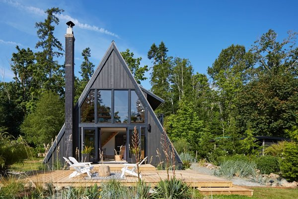Originally built in 1974 as a kit home, the A-Frame was constructed with cedar siding and metal roofing. The house faces east toward the water.