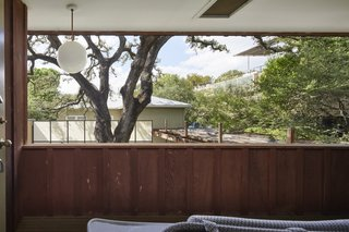 The second-floor balcony on the west side overlooks views of the majestic live oak.