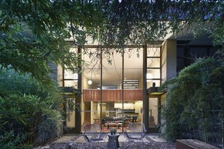 Surrounded by tall elms and thick bamboo, the rear garden is a private oasis.