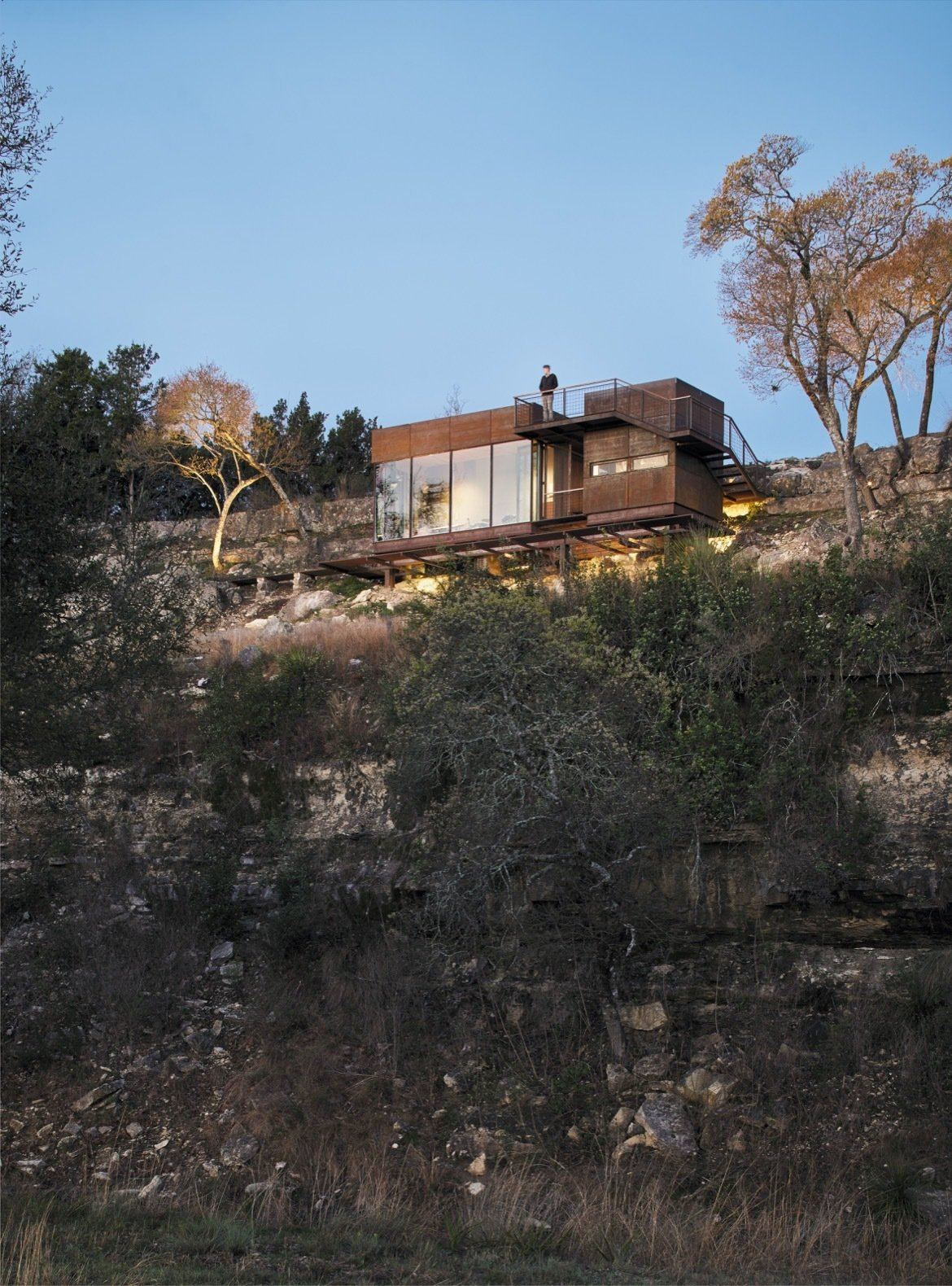 """Exterior, Metal Roof Material, Cabin Building Type, Flat RoofLine, Metal Siding Material, and Small Home Building Type """"The modern form contrasts with the Hill Country vernacular used on the rest of the 1,000-acre West Texas ranch,"""" notes the firm.    Photo 8 of 12 in An Award-Winning Writing Studio Hides Quietly in Texas"""