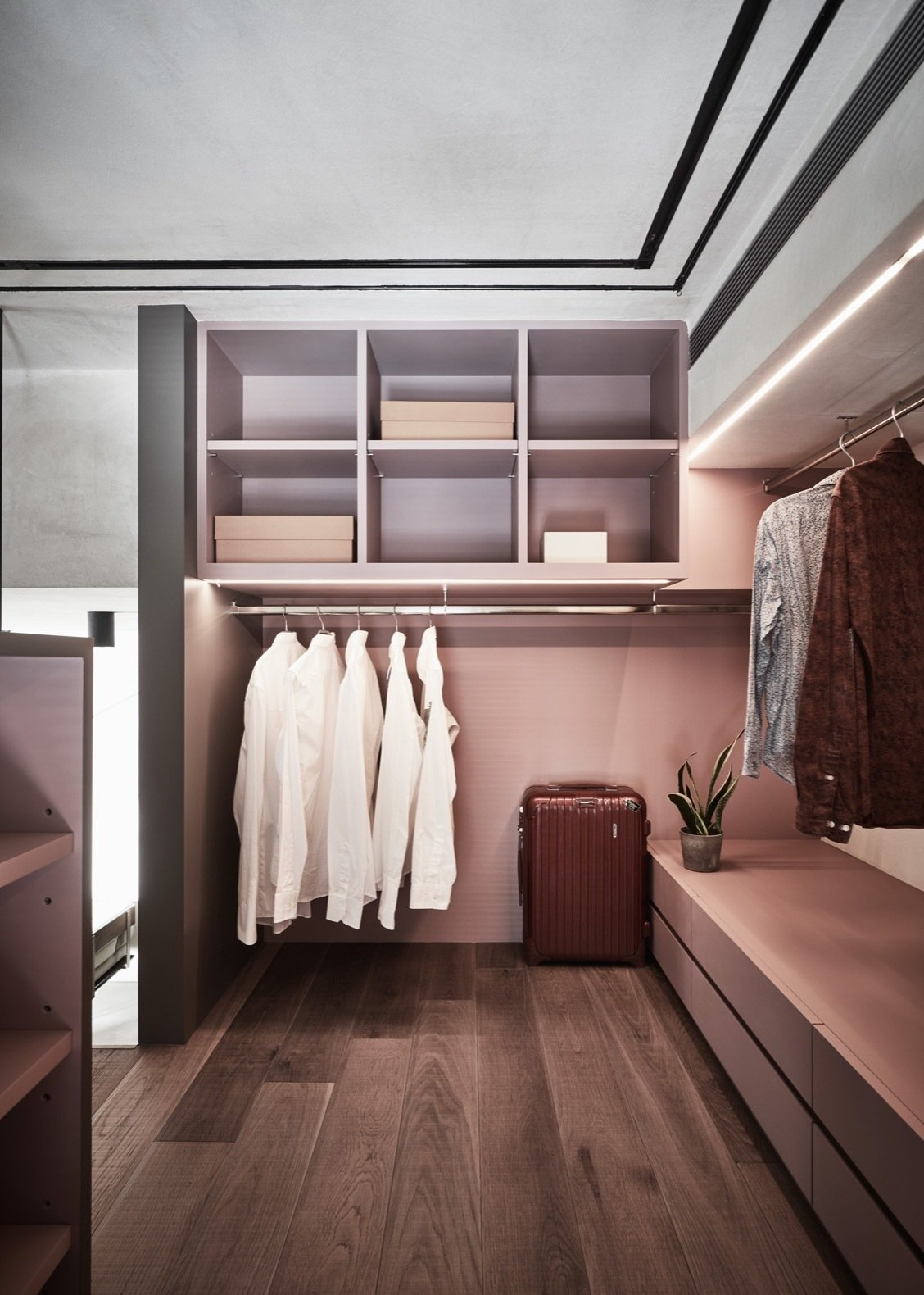 Storage Room, Closet Storage Type, and Shelves Storage Type Hidden storage and recessed lighting were key in giving the dressing room a clean and contemporary appearance.  Photo 5 of 12 in A Tiny Apartment Transforms Into a Stylish, Space-Saving Bachelor Pad For $84K