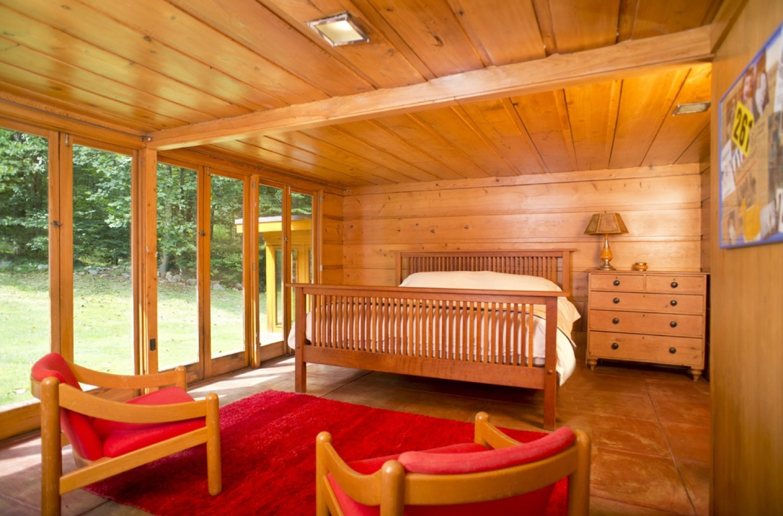 Bedroom, Dresser, Chair, Bed, Ceiling Lighting, and Concrete Floor A second bedroom originally used as the master before Tarantino Architect's extension was built.  Photo 12 of 12 in New Jersey's Oldest and Largest Frank Lloyd Wright House Cuts Price to $1.45M