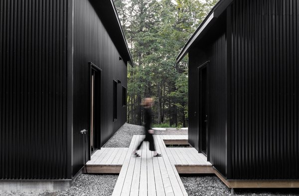 This Chic Chalet Harmonizes With Quebec's Lush Forests