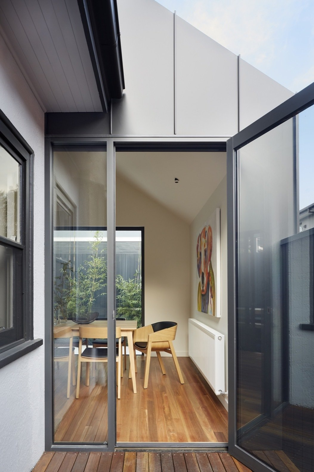 Doors, Metal, Exterior, and Swing Door Type The glazing and doors are double-glazed Capral 400 series aluminum.  Photo 6 of 16 in An Art Deco Dwelling Receives a Sleek, Contemporary Extension