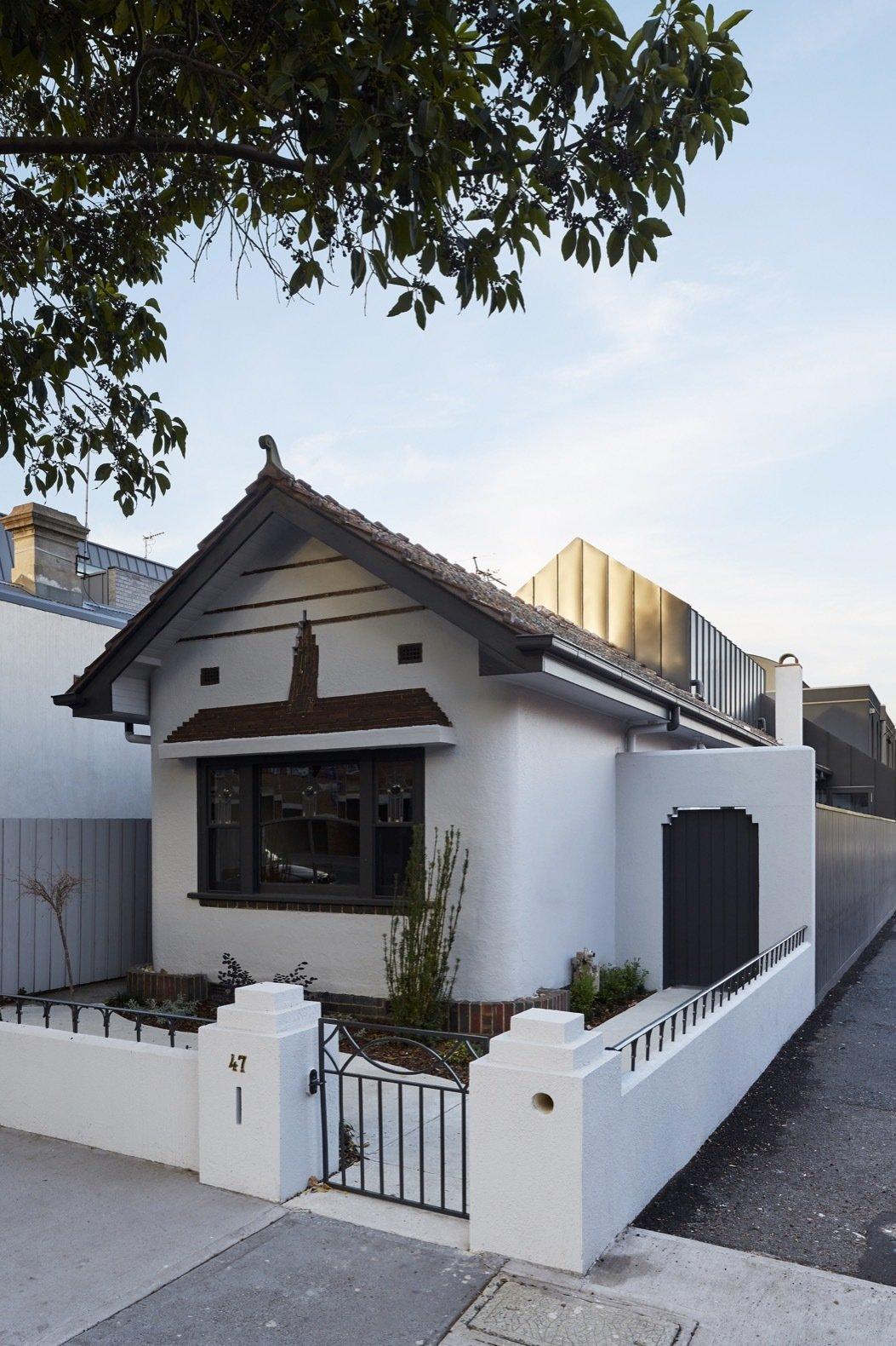 Exterior, Shingles Roof Material, Gable RoofLine, and House Building Type Built in 1938, the Shadow House retains its original curved entry porch.  Photo 1 of 16 in An Art Deco Dwelling Receives a Sleek, Contemporary Extension