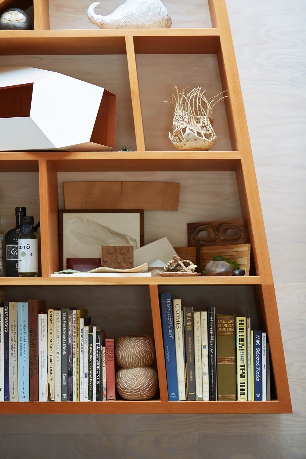 Storage Room and Shelves Storage Type The custom Douglas Fir bookshelf echoes the angles of the office.   Photo 7 of 12 in An Experimental Micro-Office Glows Like a Lighthouse in L.A.