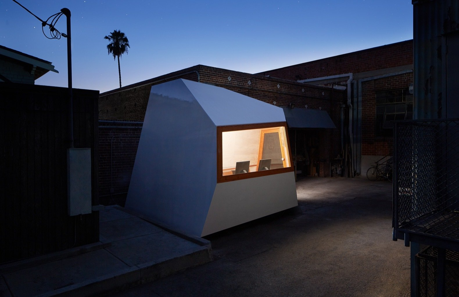 Exterior and Prefab Building Type The Lighthouse office is clad in fiberglass with Awlgrip topcoat.   Photo 1 of 12 in An Experimental Micro-Office Glows Like a Lighthouse in L.A.