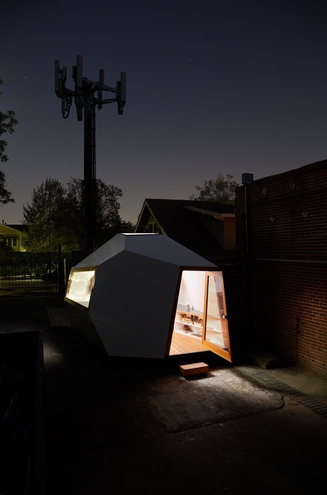 Exterior and Prefab Building Type Set on industrial casters originally designed to support roll-off dumpsters, the tiny office can be easily moved around the shop-yard.   Photo 8 of 12 in An Experimental Micro-Office Glows Like a Lighthouse in L.A.