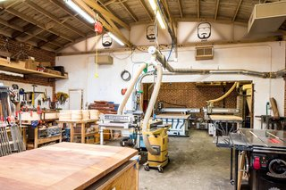 A look inside Knowhow Shop's fabrication and machine space. Moving the office out of this space freed up room for a second CNC router.
