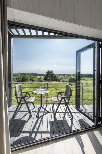 A timber terrace offers the spot for al fresco dining.