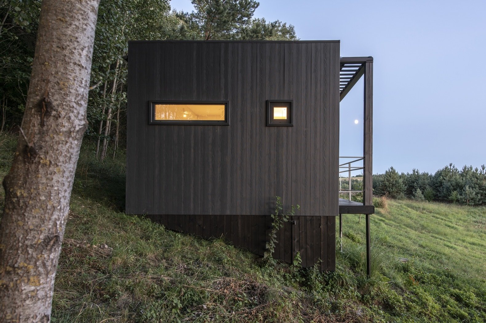 Exterior, Concrete Siding Material, Flat RoofLine, and Cabin Building Type The exterior is clad in fiber-cement panels and topped with a bitumen roof.   Photo 8 of 11 in Mingle With Mother Nature in This Tiny Prefab Getaway
