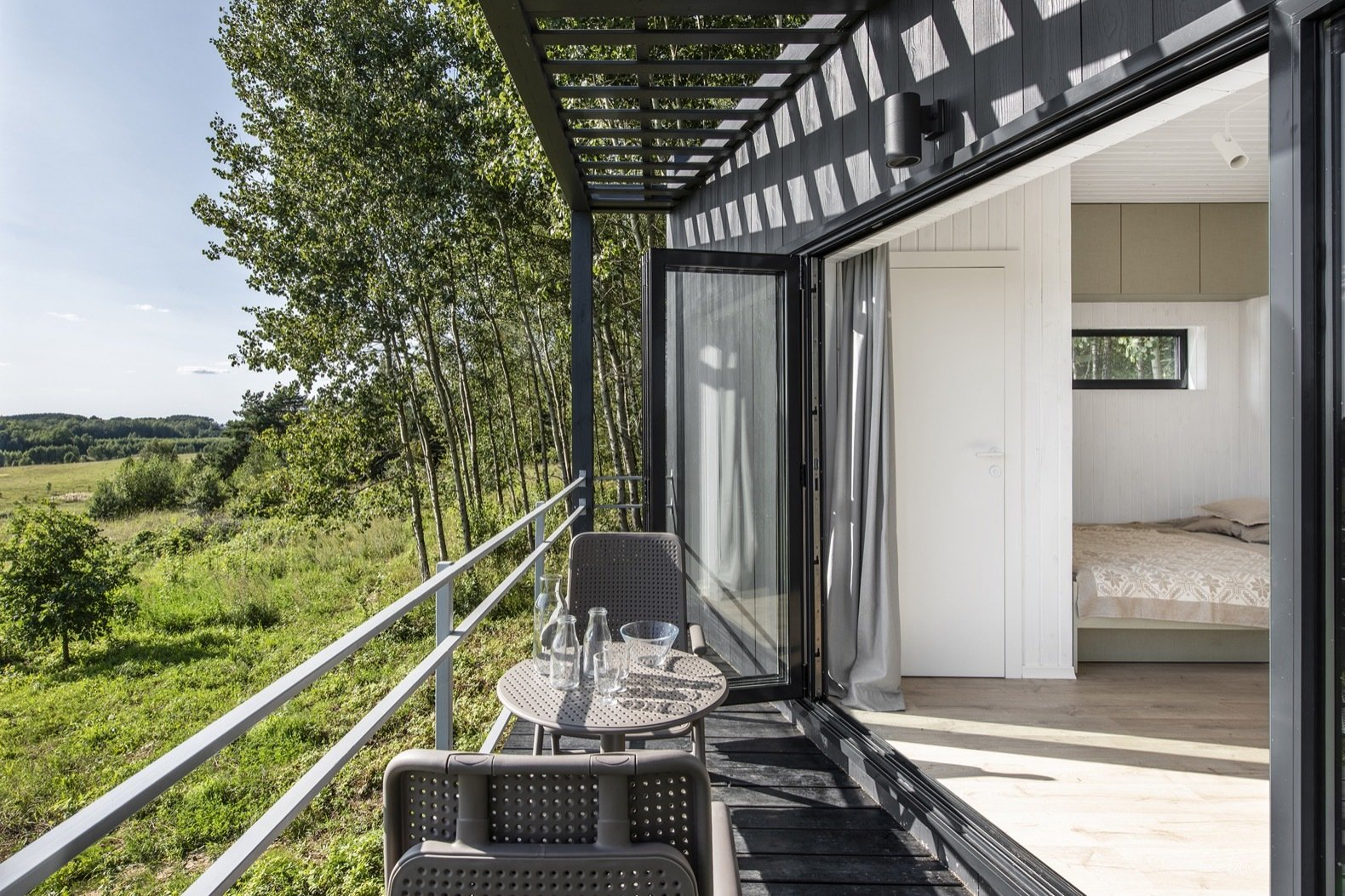Doors, Exterior, Metal, and Folding Door Type Folding glass doors blur the boundaries between the indoors and out.   Photo 4 of 11 in Mingle With Mother Nature in This Tiny Prefab Getaway