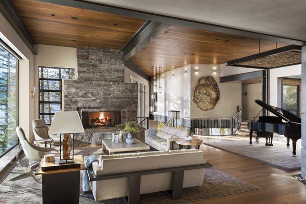 The open-plan living areas feature rift sawn white-oak floors, teak ceilings, and plaster walls that provide a soft contrast to the hard steel-beams and lines.