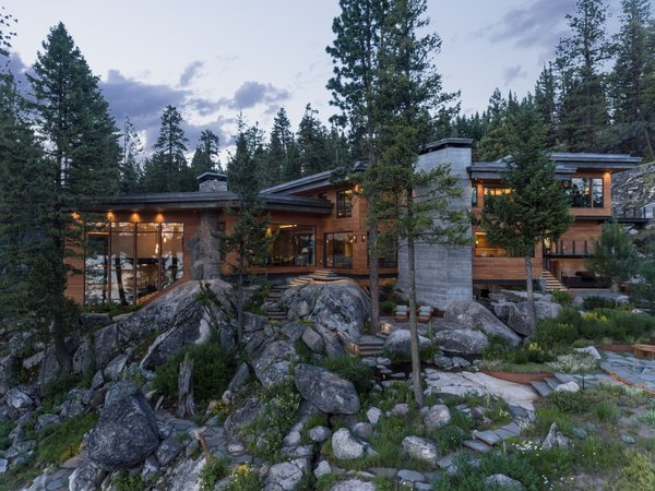 """Landscaping was strategically planned to cope the home seamlessly into the rock, with access paths from the house to the lake barely visible in some places,"" adds the firm."