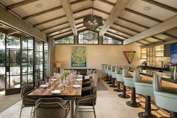 Formerly an aging dive bar, this acclaimed restaurant in Montecito, California, was transformed by AB Design Studio into an inviting and high-end eatery with a 20-foot-long custom accordion-style door system.