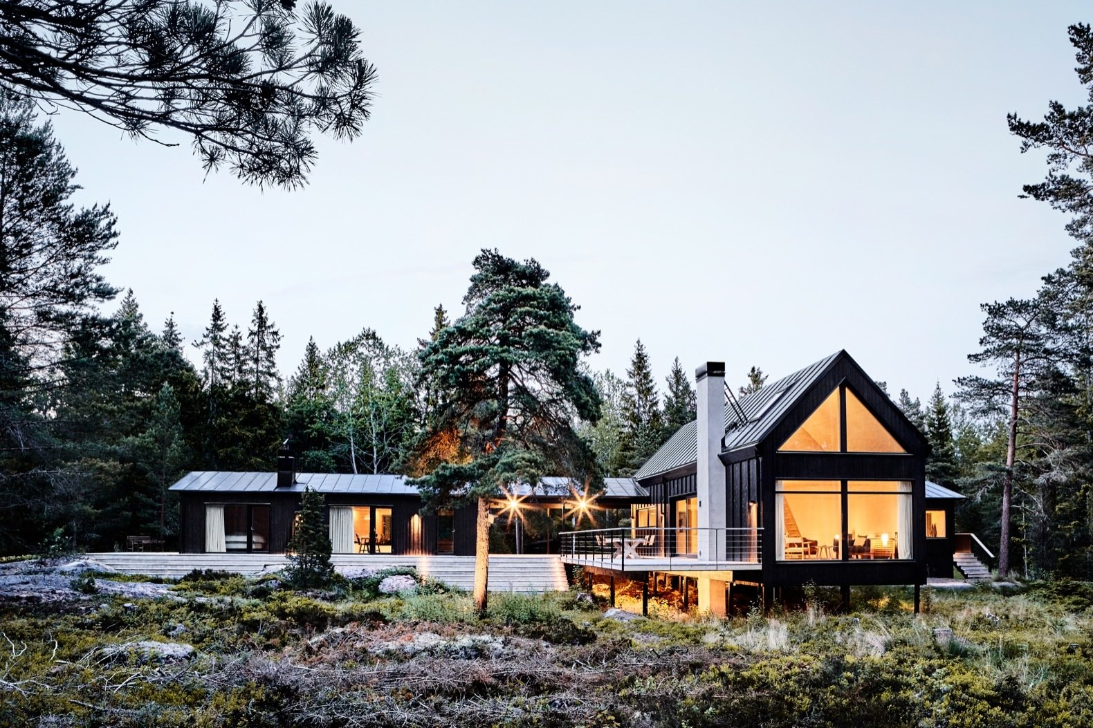 Exterior, House Building Type, Gable RoofLine, Wood Siding Material, Metal Roof Material, and Glass Siding Material The timber decking that connects the existing cottage to the new volumes emphasizes indoor-outdoor living.  Best Photos from An Inspiring Island Retreat Mixes Scandinavian Style With Japanese Simplicity