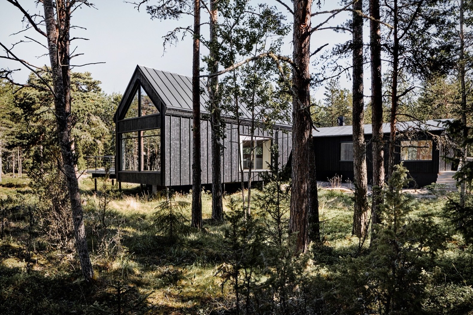 Exterior, Wood Siding Material, Metal Roof Material, Gable RoofLine, and House Building Type The volume that extends toward the south of the site (to the right of the central volume) also contains two bedrooms.    Photo 4 of 16 in An Inspiring Island Retreat Mixes Scandinavian Style With Japanese Simplicity