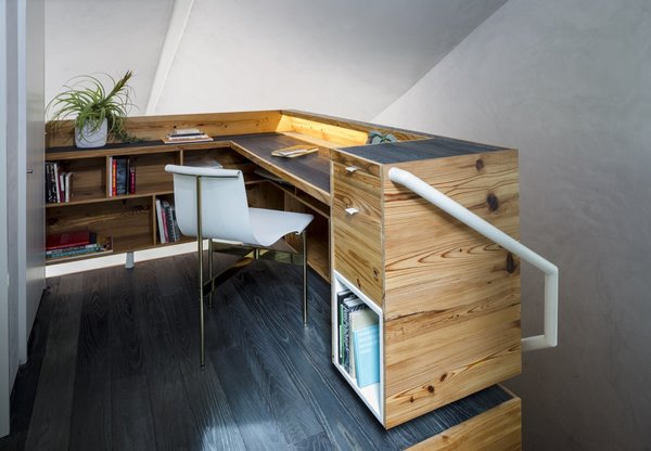 When searching for home office ideas for small spaces, even the smallest space can be utilized. In this East Austin cottage by Studio 512, a second-floor landing makes a perfect home office with plenty of storage thanks to built-in shelves. The office backs up to the laundry unit concealed behind a door.