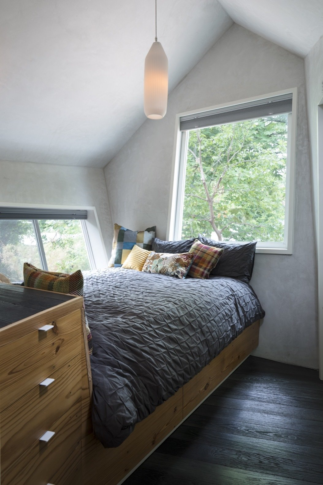 Bedroom with single pendant light above center of room