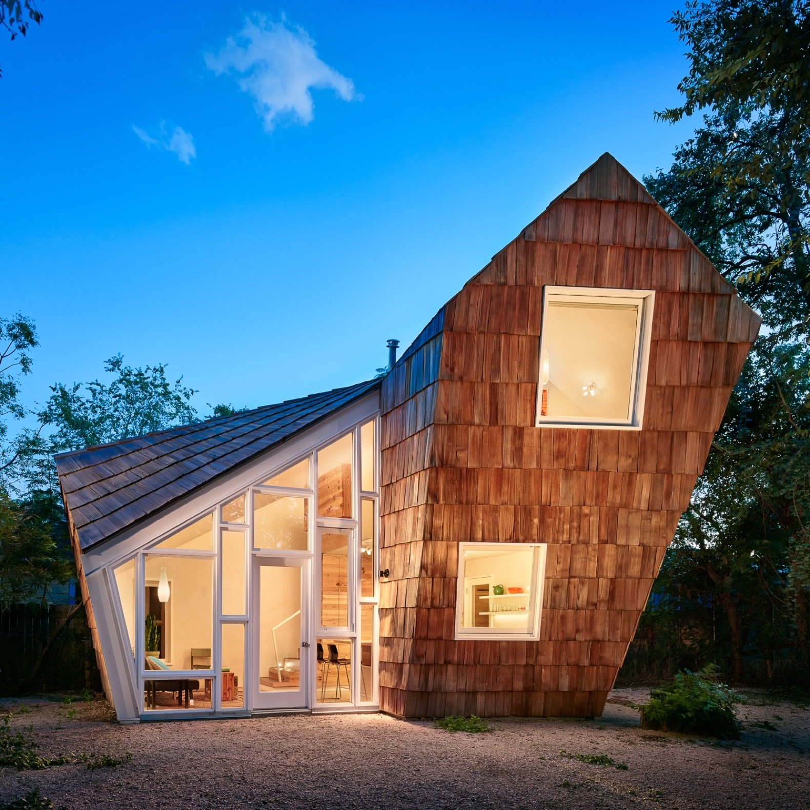 Exterior, Shingles, Wood, House, Gable, Small Home, and Shed The Hive was completed in May 2015 for a total construction cost of $160,000.  Best Exterior Small Home Gable House Photos from A Whimsical Guest House Leans Out to Maximize Space