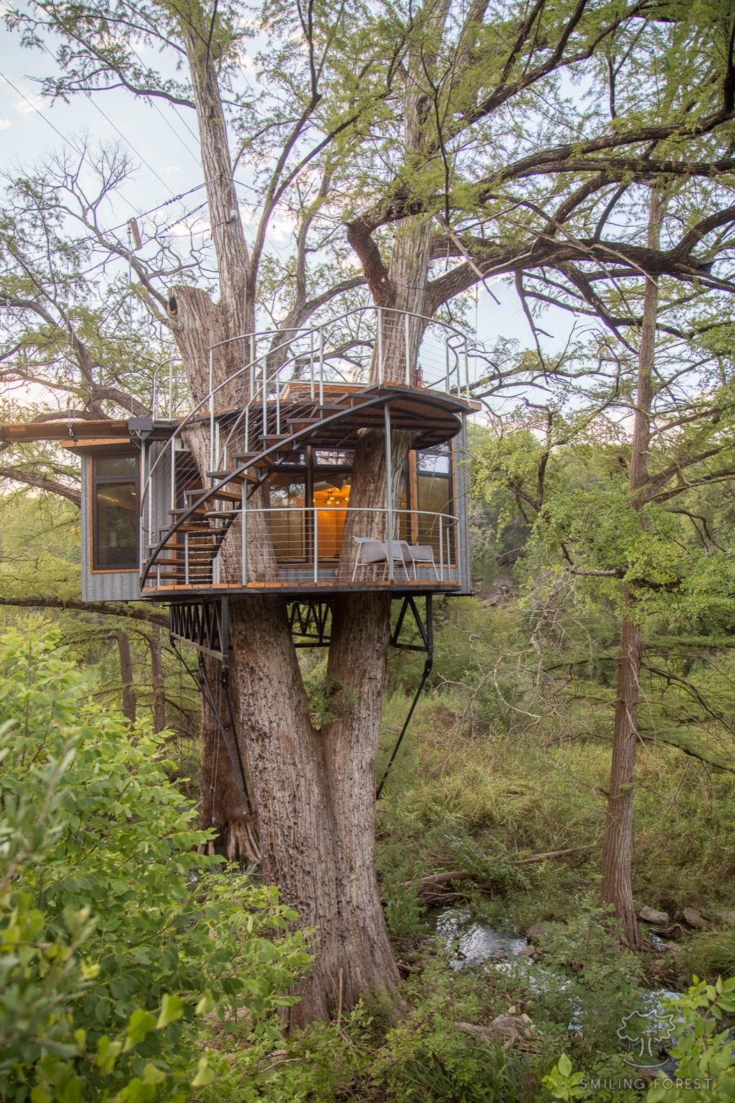"Exterior, Treehouse, Metal, Flat, and Metal ""The most challenging part of the project was the fact that the foundation started 25 feet in the air. Until the foundation was built, every piece of material needed to be rigged into place via ropes, chains, and cables,"" Will says.    Exterior Metal Treehouse Photos from Escape to the Texan Treetops in This Eco-Luxe Treehouse"