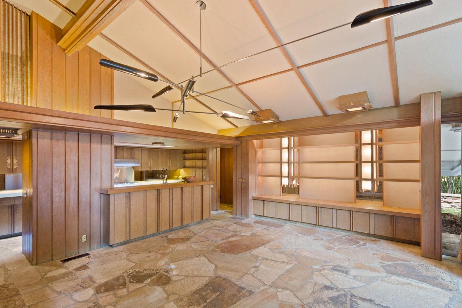 Dining, Accent, Storage, Bar, Shelves, Bench, Pendant, and Ceiling There are over 300 custom-made cabinet doors in the home, as well as custom light fixtures.    Best Dining Ceiling Shelves Photos from A Midcentury Masterpiece by E. Fay Jones Hits the Market at $1.8M