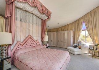 Elvis memorabilia punctuates the master bedroom.