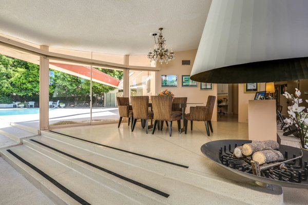 Full-height glazing connects the living spaces with the outdoors, promoting easy indoor/outdoor living.