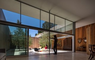 Walls of operable glass by Fleetwood create a seamless flow between the indoors and out.