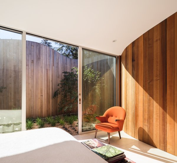 The additional bedroom also enjoys direct access to an outdoor courtyard.