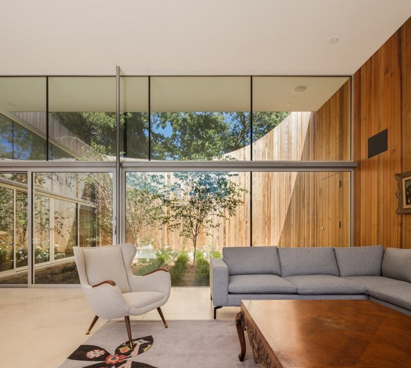 The living room is flanked with views of two courtyards to the north and south.