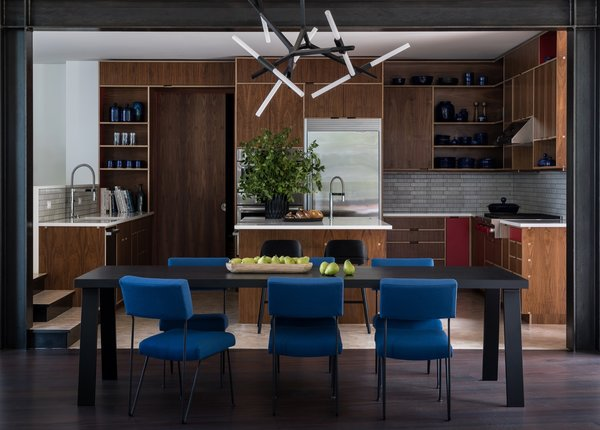 The open kitchen features Pental Quartz countertops, walnut plywood cabinetry by Kerf Design, and a ceramic tile backsplash from Ann Sacks Savoy Collection. The Muuto Nerd counter stools are from DWR.
