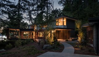 Set on a one-acre wooded bluff overlooking Puget Sound, the Tree House is clad in low-maintenance materials including Cor-Ten steel, stained cedar shiplap, and painted HardiePlank.