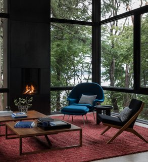 The side chair is a Vintage Dux Scissor chair by Folke Ohlsson. The coffee tables are Blu Dot Strut tables in walnut.